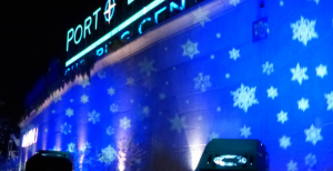Snowflakes Projected Against A Blue Backdrop Create Stunning Exterior  Architectural Lighting On This Commercial Building.