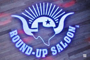 The Round-Up Saloon projects their logo with a custom gobo on the dance floor to promote social media sharing.