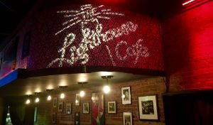 The Lighthouse Cafe projects a custom gobo behind their stage to promote social media sharing.