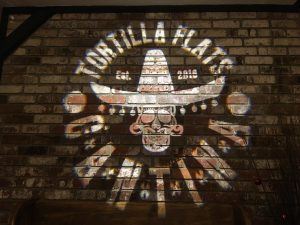 Tortilla Flats Cantina in Placerville, Ca projects a custom gobo with their logo in the entryway to promote social media sharing.