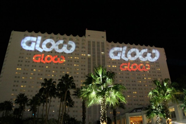 Branded signage like this exterior logo projection is critical for workplace branding