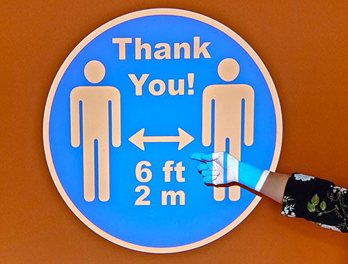 Safely reopen your business with COVID-19 virtual signage like this social distancing sign.